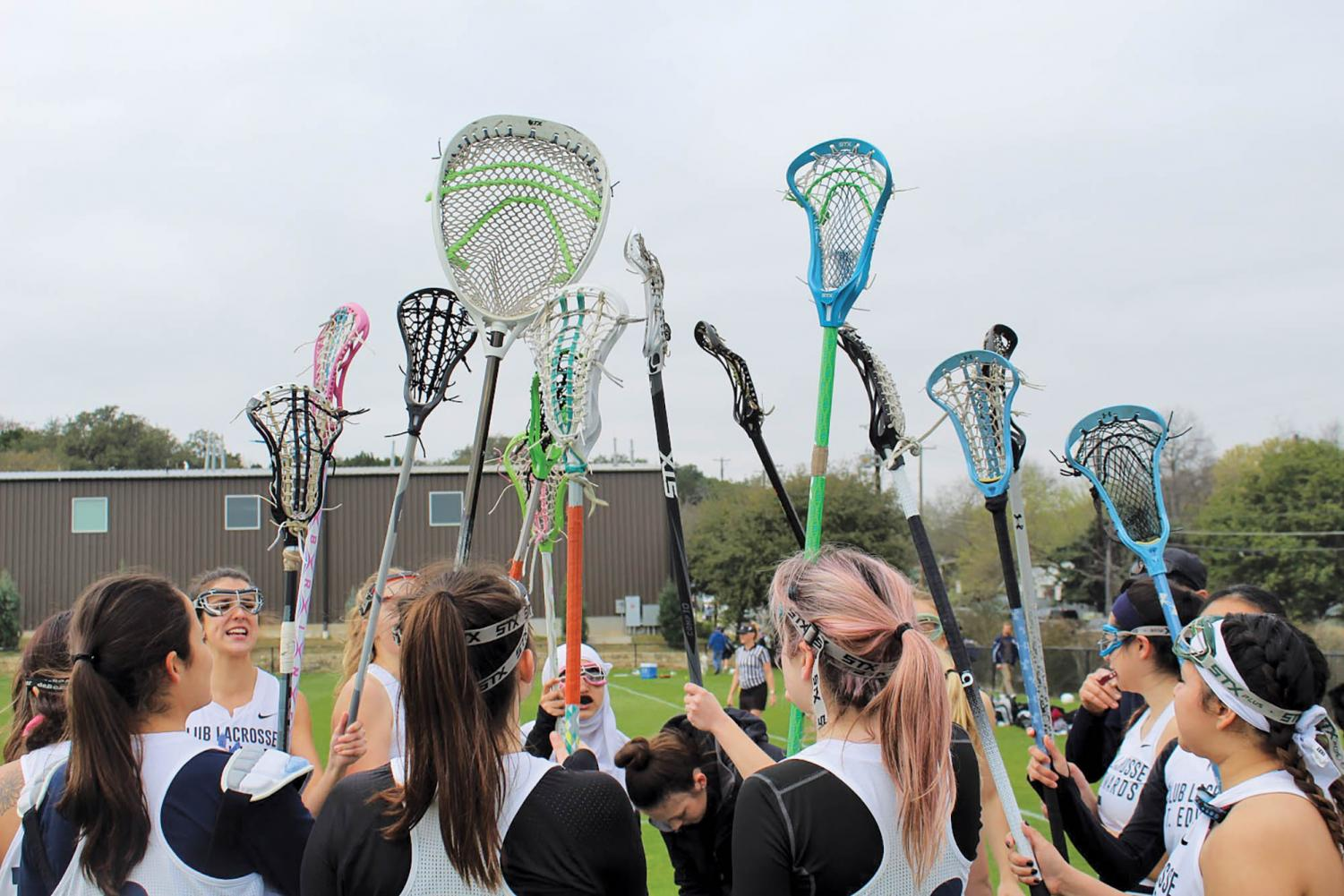 Huddling up after a productive team practice, the women's lacrosse team prepares to improve their skillsets in preparation for upcoming tournaments.