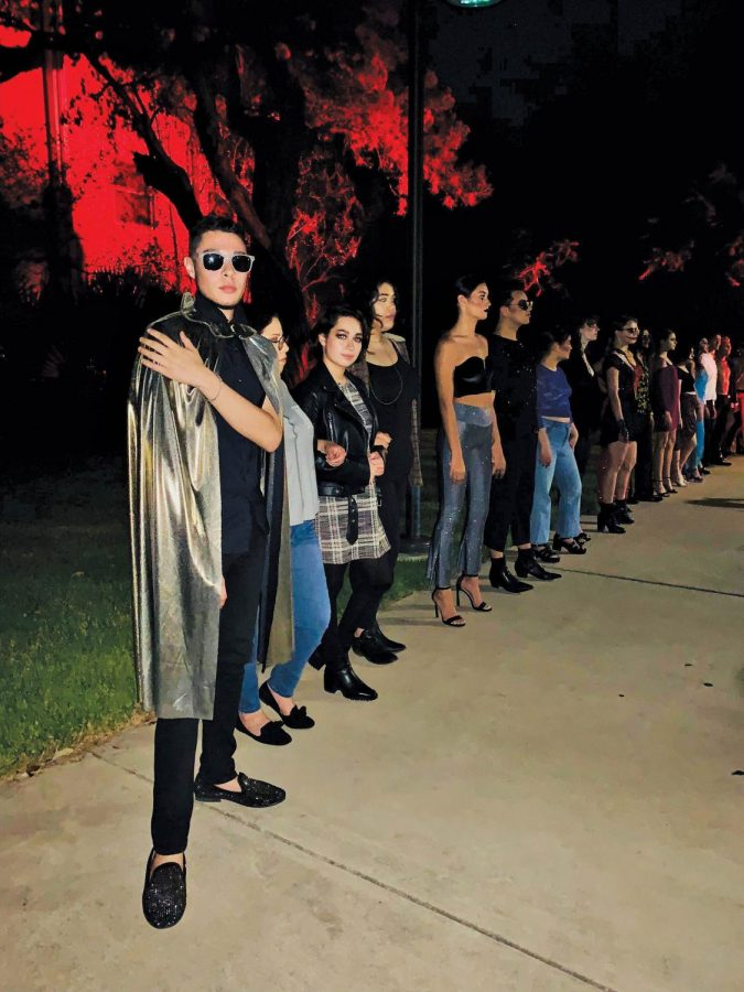 The team of designers and models, led by John Mascorro, pose following the show. Ana Jaime sports a black leather jacket. Jaime lead the makeup team, getting models ready in special-effects makeup.