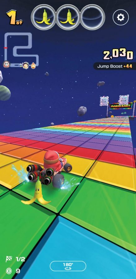 Shy Guy races to the finish line on Rainbow Road SNES on the new nintendo mobile game.