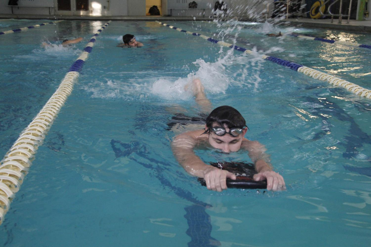 Club member Andrew Jusbasche completes his lap during the team's weekly practice sessions.
