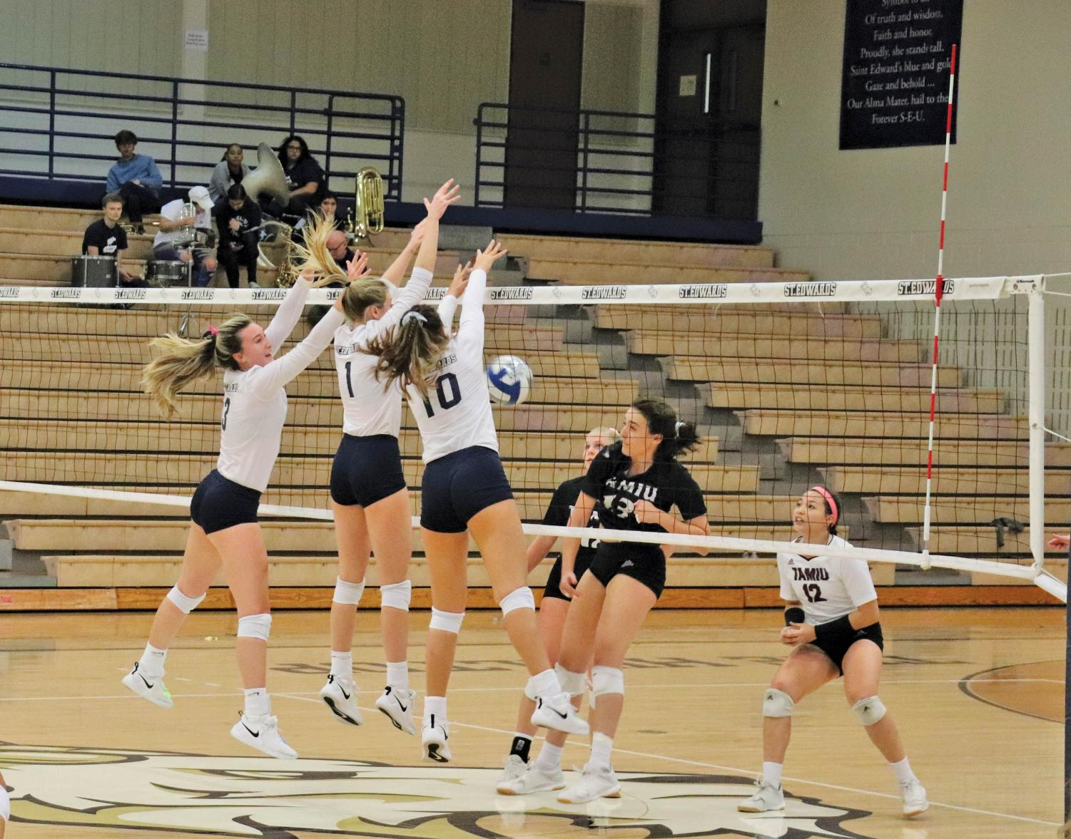 The entire SEU front row swarms to block a spike from Texas A&M Kingsville. SEU beat TAMIU 3-0.