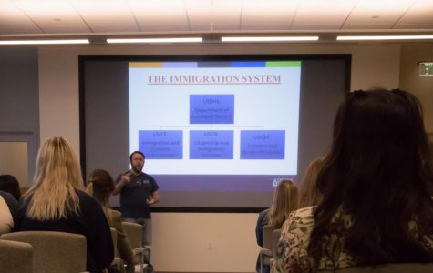 Justin Estep explains immigration system to audience members. The panel was part of events organized by Monarchs on the Hilltop for their Undocuweek.
