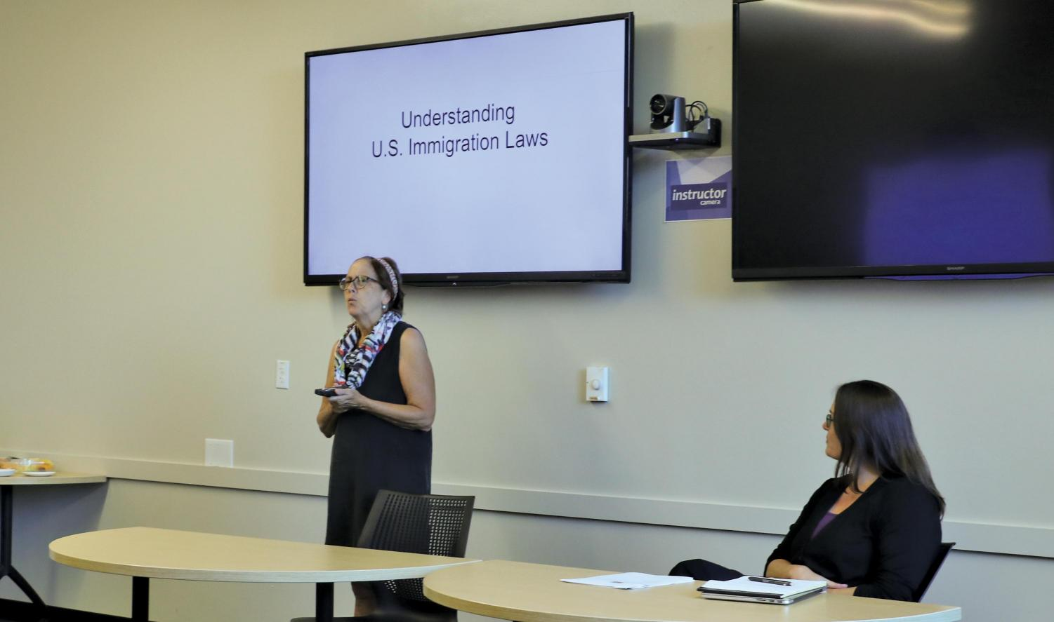 Sarah Woelk of Casa Marianella speaks about U.S. immigration laws. Woelk has been a part of the legal clinic staff at Casa since 2011.