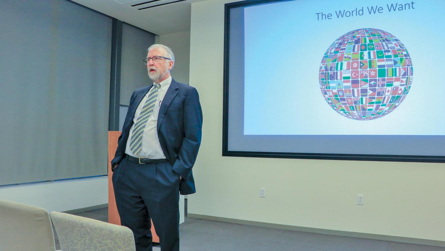 Paul Allen Miller speaks to students in Fleck Hall about globalization within universities. Miller has a Ph.D. in comparative literature and a master's degree in classics from The University of Texas.