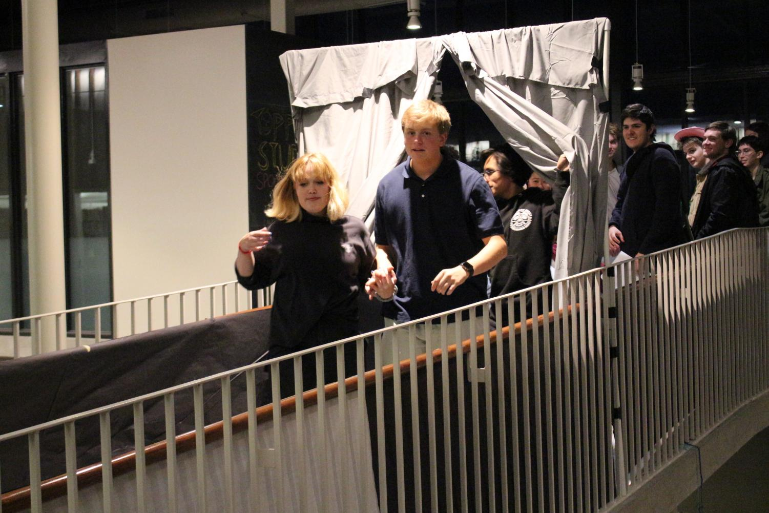 Visitors enter the haunted house located on the second floor of the Munday Library.