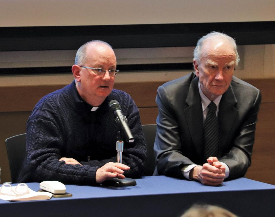%28Left+to+right%29+Father+Peter+Walsh%2C+Director+of+Campus+Ministry%2C+and+President+Martin+sit+on+the+panel+for+the+annual+meeting.+Martin+emphasized+the+Holy+Cross+mission+at+the+start+of+the+event.