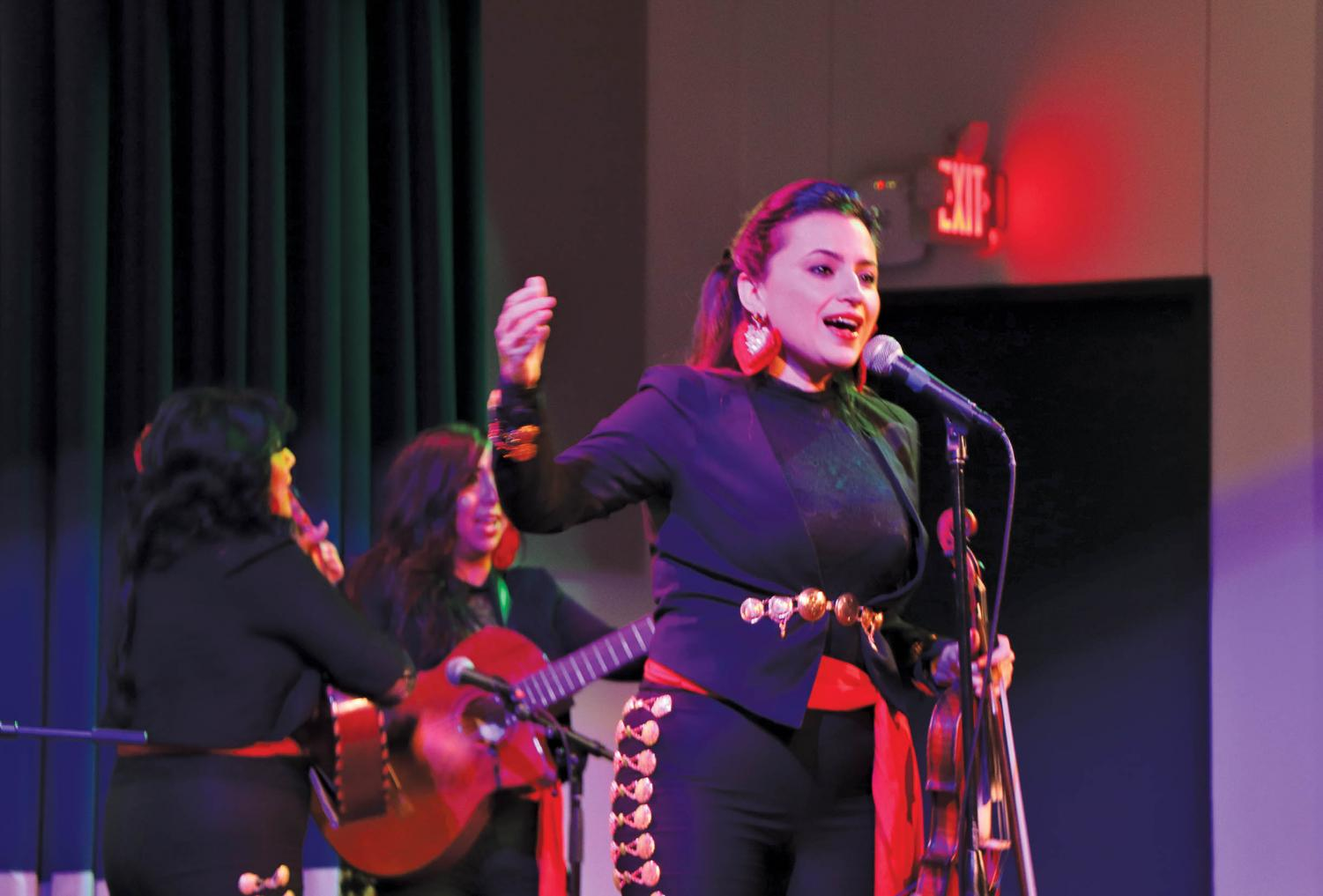 Vanessa del Fierro  leads the Las Coronelas in song and dance. Del Fierro founded the band back in 2010.