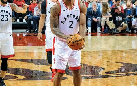 Kawhi Leonard prepares for a free throw during his lone season with the Toronto Raptors. Leonard believes that sitting out games played a factor in the team's title run.