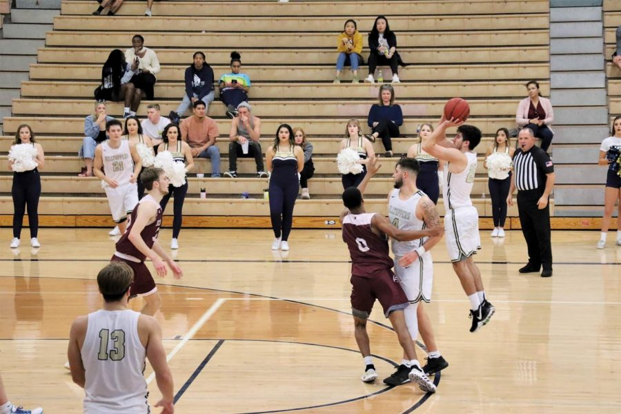 Junior guard Ryan Garza shoots a three-pointer as senior forward Dorian Lopez sets a screen. Garza looks forward to reassuming his role as sixth-man for the 2019 Heartland Conference Champions.