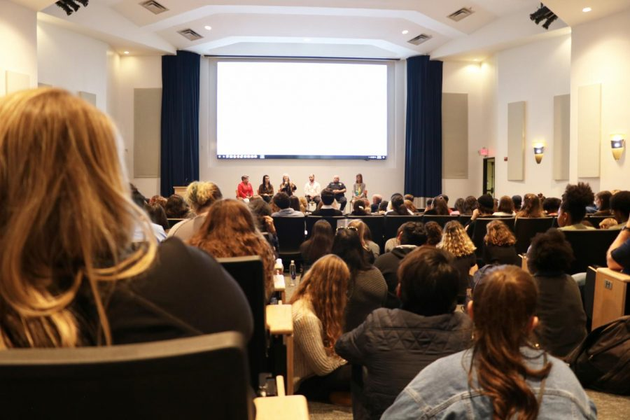 Jones+Auditorium+filled+to+capacity+following+an+announcement+SGA+and+IOU+made+Monday.+Attendees+sat+on+the+floor+and+stood+at+the+back+of+the+room+due+to+overflow.