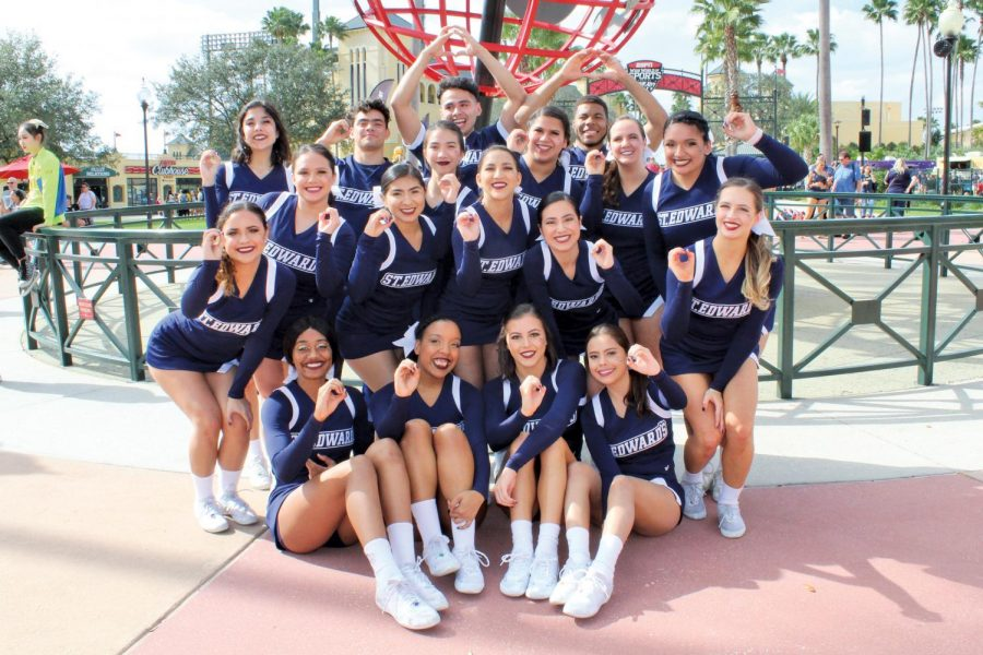 SEU cheerleaders gesturing a zero to signify their zero deduction routine at the National Championship in Orlando, Florida. The team earned a ninth-place finish against 15 other schools.