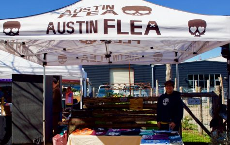 "Garcia, an Austin Flea employee, is seen selling T-shirts. ""Everything here is unique. Jewelry tends to have the most people creating and selling, so we try to balance it out by also including organic soaps, clothing, food, original designs, and even CBD joints. We really feature a little bit of everything,"" Garcia said."