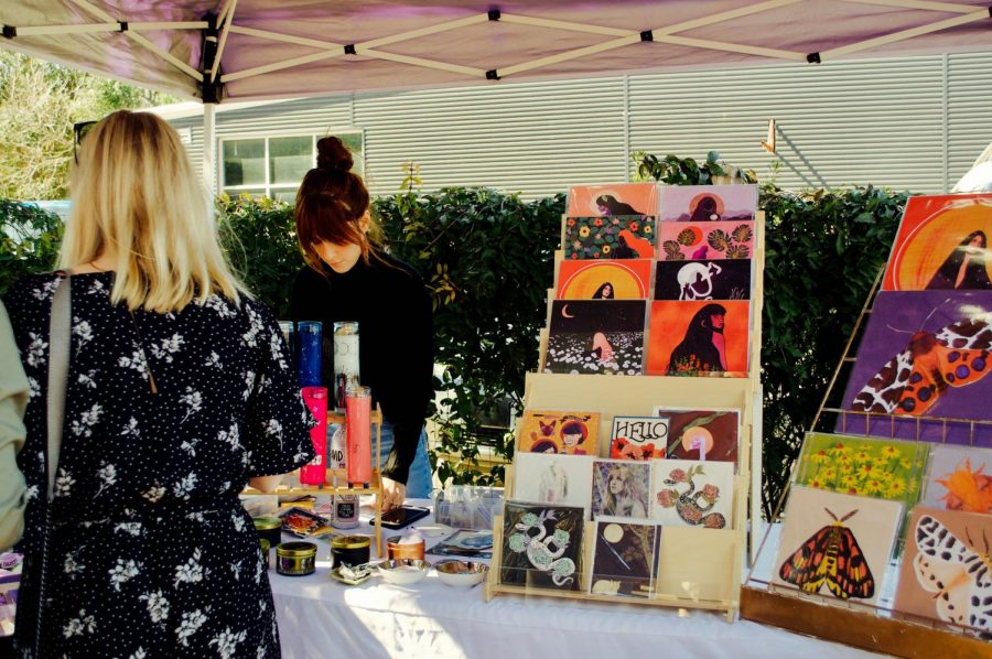"Cayce Matteoli, founder of Earthereal Design, creates and sells multiple-sized prints, cards, candles, stickers and wrapping paper. ""I was in a band and toured for six years, and I was making all of our posters,"" Matteoli said. ""Then, my friend had me make her wedding invitations, and they had such a good response from that it inspired me."""