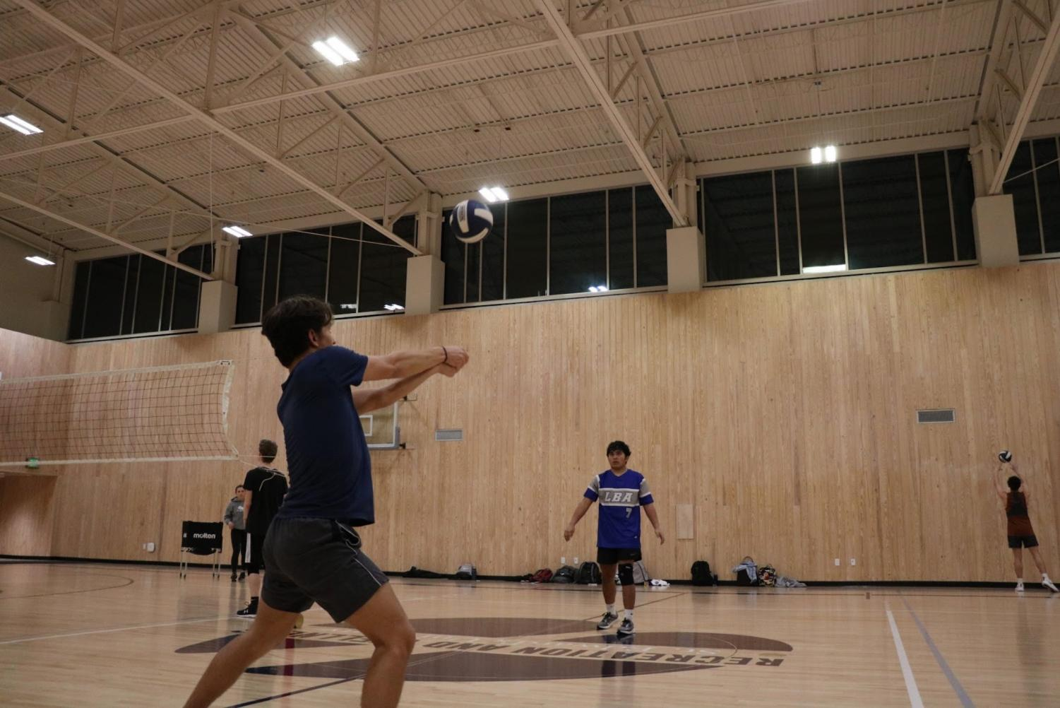 St. Edward's student Rory O'Connor bumps volleyball to his warmup partner during a weekly practice. The club team practices Monday and Wednesday evenings.