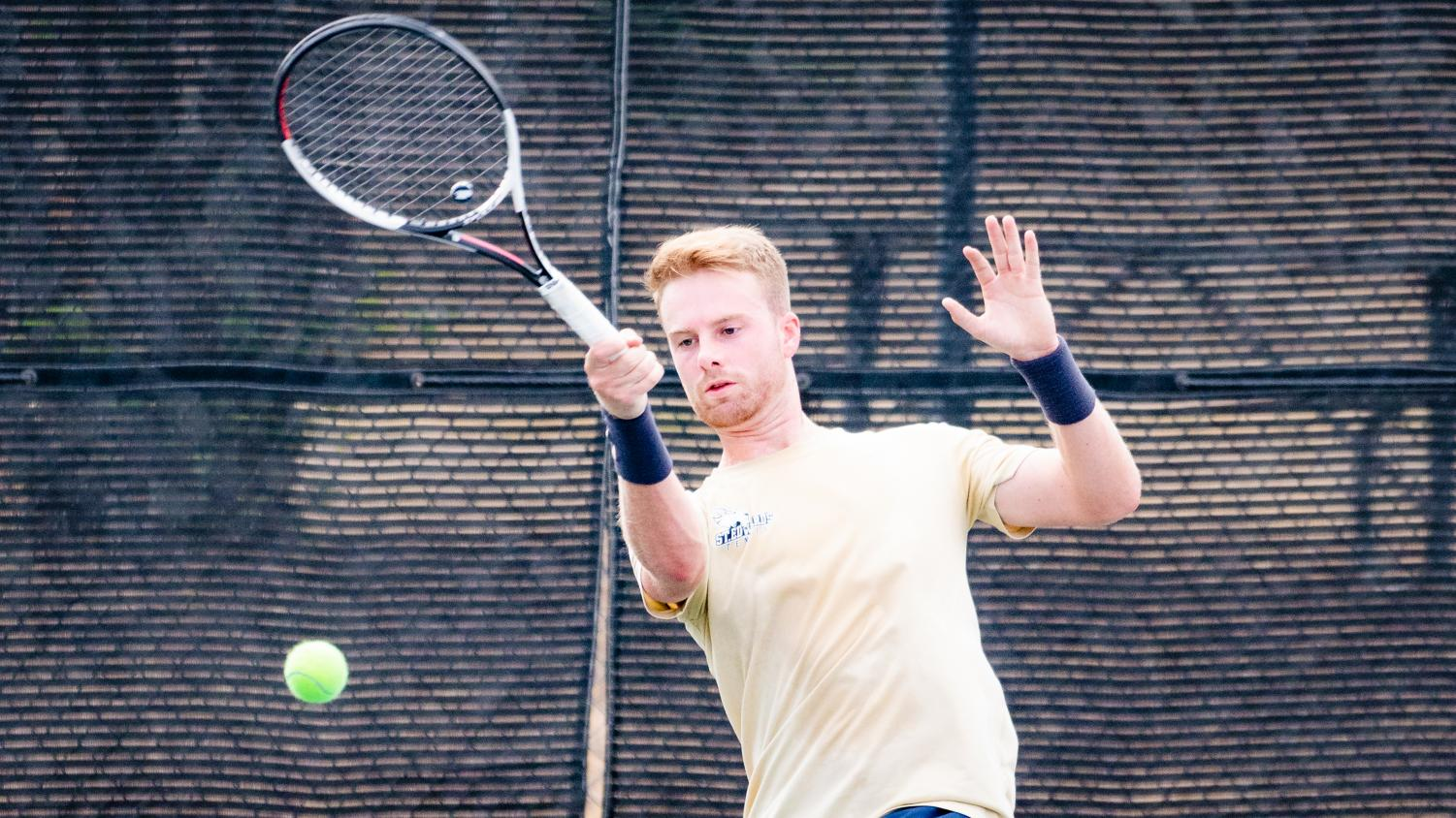 Senior Zac Robinson strikes a forehand shot during a match. Robinson earned the Lonestar Conference Player of the Week for his three victories during last weekend's doubleheader.