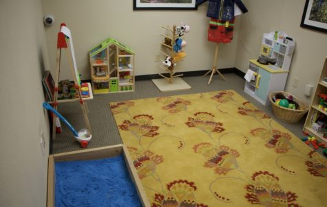 The Community Counseling Center is home to several patient rooms for families and couples. This room is a children's center featuring a play area with various toys.
