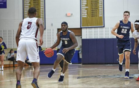 Senior forward Justin Robinson drives to the paint during a 125-66 victory over Dallas Christian College in 2018. Robinson was a contributing factor in the Hilltoppers winning the 2018-2019 Heartland Conference Championship.