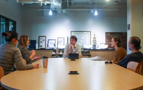 Travis Williams (center) is the only archivist for Munday Library. Williams oversees the Archives and Special Collections section of the library.