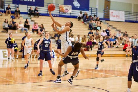 Deijah Blanks (in white) draws sooting foul off of UAFS defender. The Hilltopers finished the regular season 13-9 in conference play.