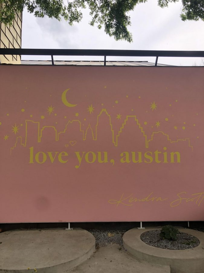 A bright pink mural displays support for Austin in troubling times. SXSW Unofficial was hosted by Kendra Scott, a well-known jewelry company.