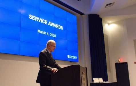 During the annual President's Meeting, the university president addresses the St. Edward's faculty and staff about the state of the campus. The meeting also included service awards given to faculty and staff.