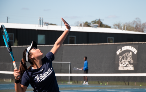 Freshman Camila Baeza prepares a serve during a weekly practice. As a newcomer, Baeza is already making an impact for the team as her win against St. Mary's has contributed to the Hilltoppers' 6-0 start.
