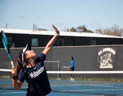 Freshman Camila Baeza prepares a serve during a weekly practice. As a newcomer, Baeza is already making an impact for the team as her win against St. Mary