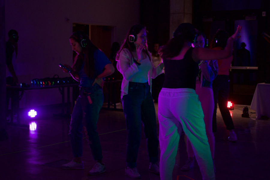 Students hit the dance floor at silent disco. On the dance floor, you can choose to group together on the same station with friends or go your own way.
