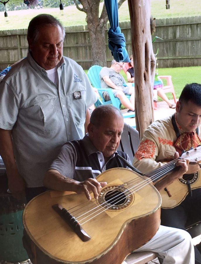 Martinez's tio Raymond Martinez playing the guitarron. The guitarron is a six-string guitar usually used in mariachi.
