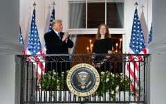 President Trump and Justice Amy Coney Barrett stand together on the Blue Room balcony following Justice Barrett's swearing-in ceremony. Barrett was nominated on Sept. 26.