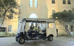 Denise Mares and Samuel Barrios are two drivers for SafeWalkSEU. Due to COVID-19, volunteers are required to wear masks and riders face away from them in the golf carts.