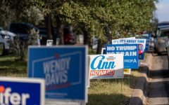 Democratic candidate yard signs line streets in south Austin. Depending on the election results, Texas may turn to a blue state or remain red.