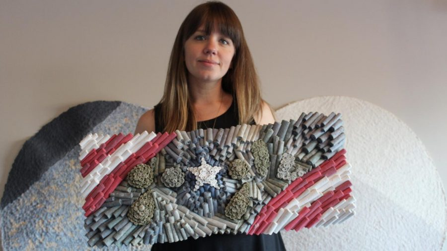 Jenn Hassin poses with her completed work. Veterans Day is observed annually on Nov 11 and honors all who have served in the US Armed Forces.