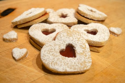 Linzer cookies originated from Austria. They are sandwich cookies filled with jam or fruit preserves.
