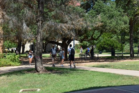 After two and a half semesters of online classes, students walk on-campus at St. Edwards University to their in-person classes. Even though classes are back in session, guidelines including mandatory masks are required to be worn while on-campus.