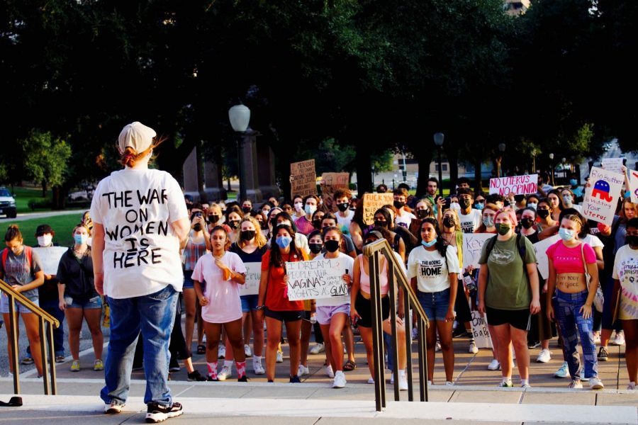 Protests around the new, strict laws on abortion have begun outside of the Texas Capitol building in Austin. A crowd of predominantly women listen as the speaker proclaims that this law means the war on women is here.