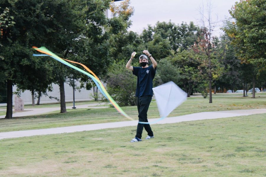 A St. Edward's University student participates in the kite festival on St. Andre Lawn. The festival marked the end of summer.