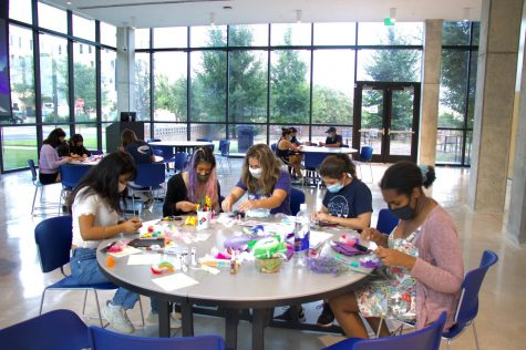 St. Edward's students focus intently on creating their origami. Origami is a Japanese word that is used to refer to the art of paper folding. It's an inclusive term for all forms of folding practices.