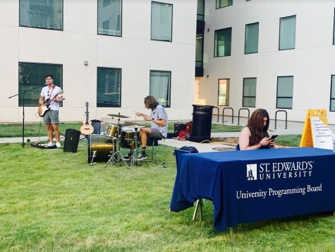 """Students Evan Autin and Ian Clennan performed together for University Programming Board and Resident Life's """"Musicians on the Lawn""""  last Monday. Clennan played the drums while Autin was lead vocals and guitar."""